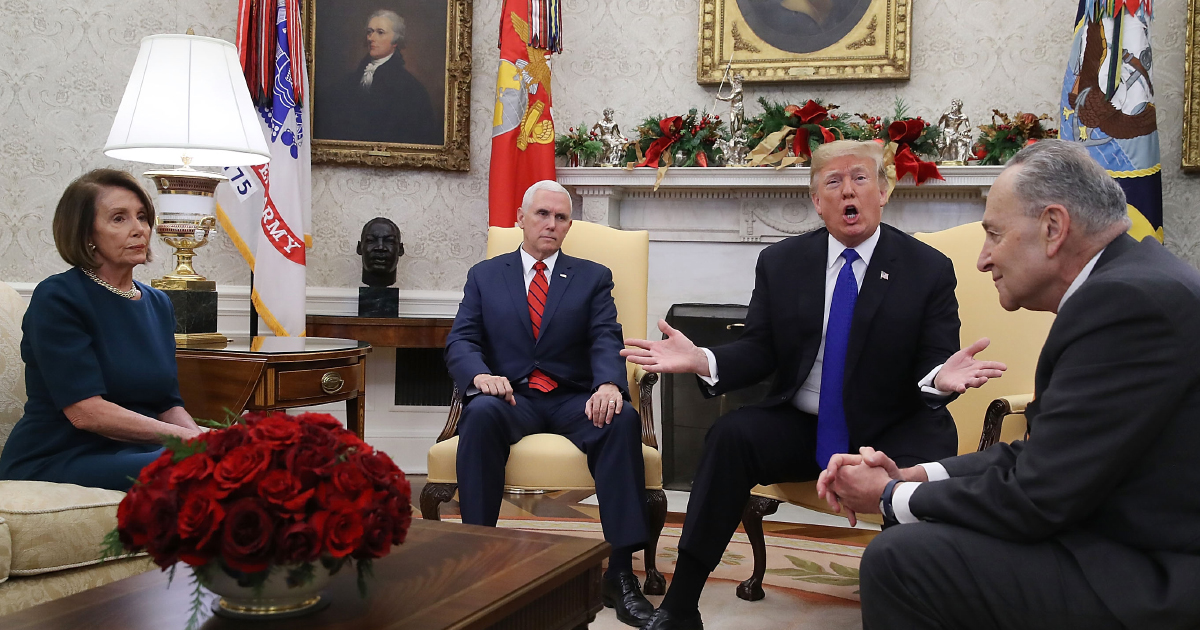 President Donald Trump argues about border security with Senator Chuck Schumer and Representative Nancy Pelosi as Vice President Mike Pence sits nearby in the Oval Office on December 11, 2018