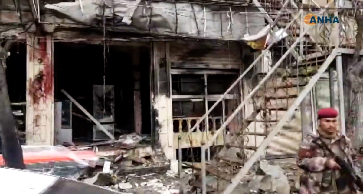 This image grab taken from a video published by Hawar News Agency shows the aftermath of a suicide attack in the northern Syrian town of Manbij. - A suicide attack targeting US-led coalition forces in the flashpoint northern Syrian city of Manbij