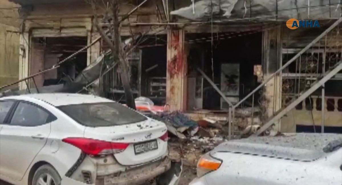 The aftermath of a suicide attack in the northern Syrian town of Manbij. - A suicide attack targeting US-led coalition forces in the flashpoint northern Syrian city of Manbij