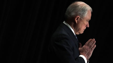 Jeff Sessions listens as he is introduced during the Justice Department's Executive Officer for Immigration Review Annual Legal Training Program June 11, 2018 in Tysons, Virginia.