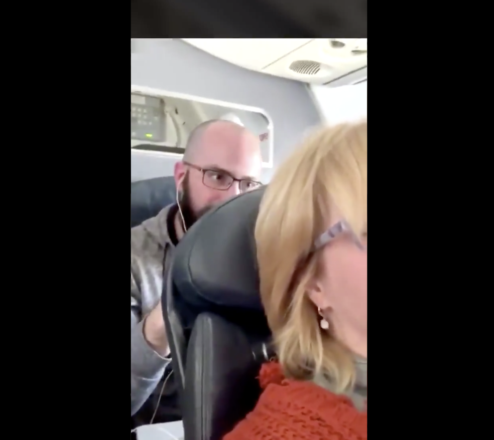 Woman Posts Video of Nightmare Passenger Repeatedly Punching Her Seat During Flight