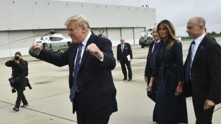 US President Donald Trump gestures as he arrives at John Murtha Johnstown-Cambria County Airport in Johnstown, Pennsylvania with First Lady Melania Trump, on September 11, 2018 en route to Shanksville, Pennsylvania.