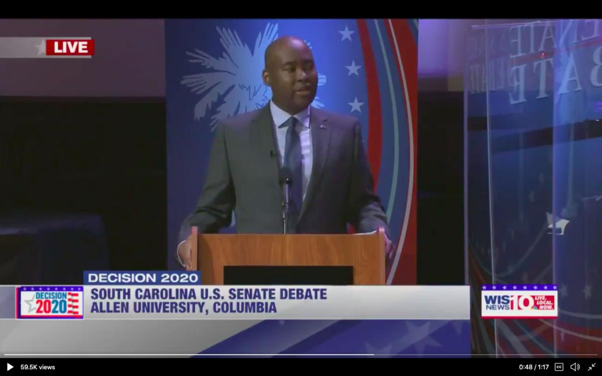 Jaime Harrison brought a plexiglass divider to debate Lindsey Graham