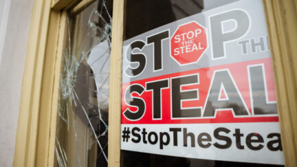 'Stop the Steal' sign posted in broken window in U.S. Capitol