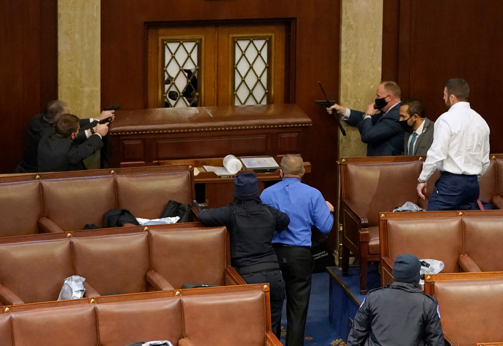Capitol Police point their guns at rioters trying to breach door to House floor