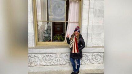 Jenna Ryan Posing Next to Broken Window at US Capitol
