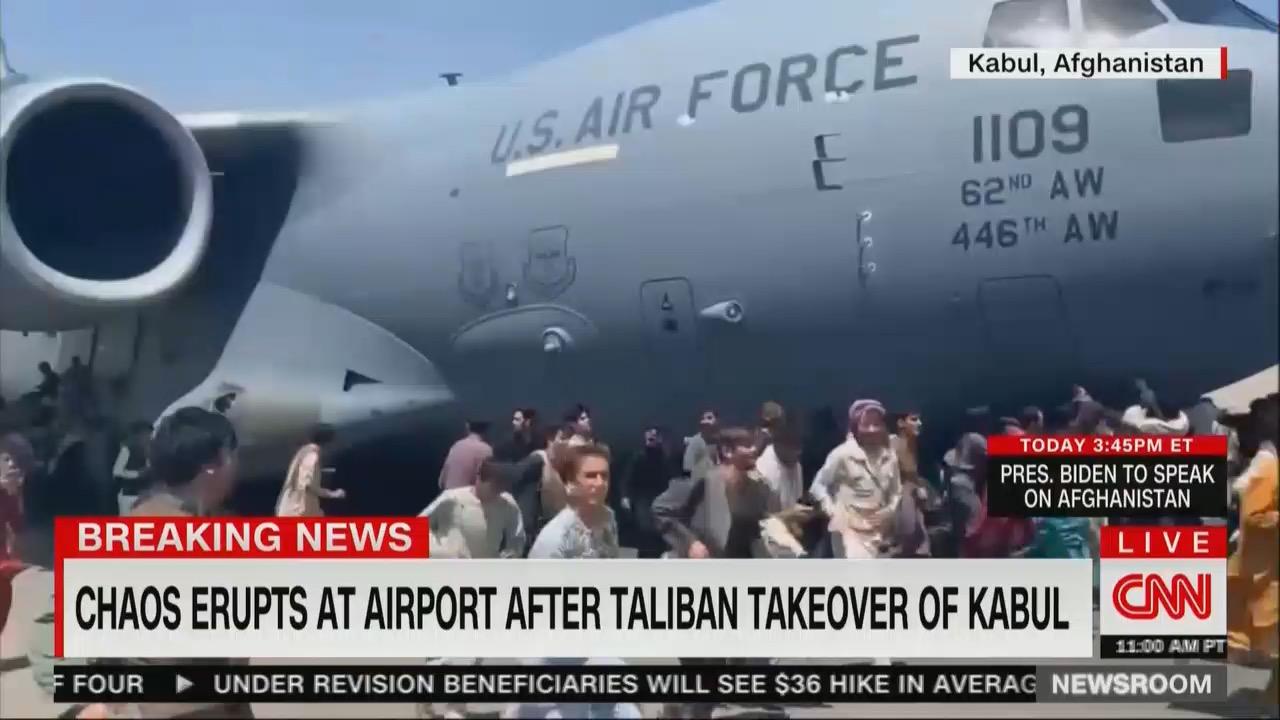 Afghans alongside a US Air Force plane