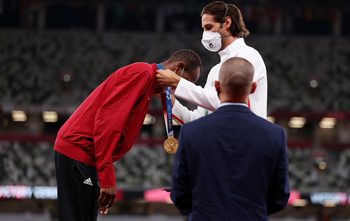 oint gold medalist Gianmarco Tamberi of Team Italy presents gold medalist Mutaz Essa Barshim of Team Qatar with his medal on the podium during the medal ceremony for the Mens High Jump on day ten of the Tokyo 2020 Olympic Games at Olympic Stadium on August 02 2021 in Tokyo Japan