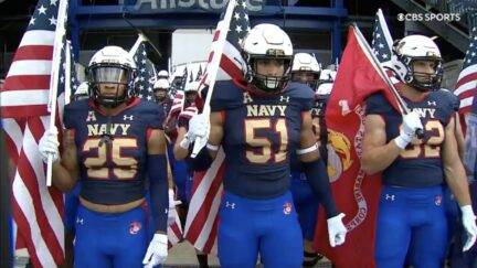 navy football team carry flags onto field to honor 9/11 anniversary