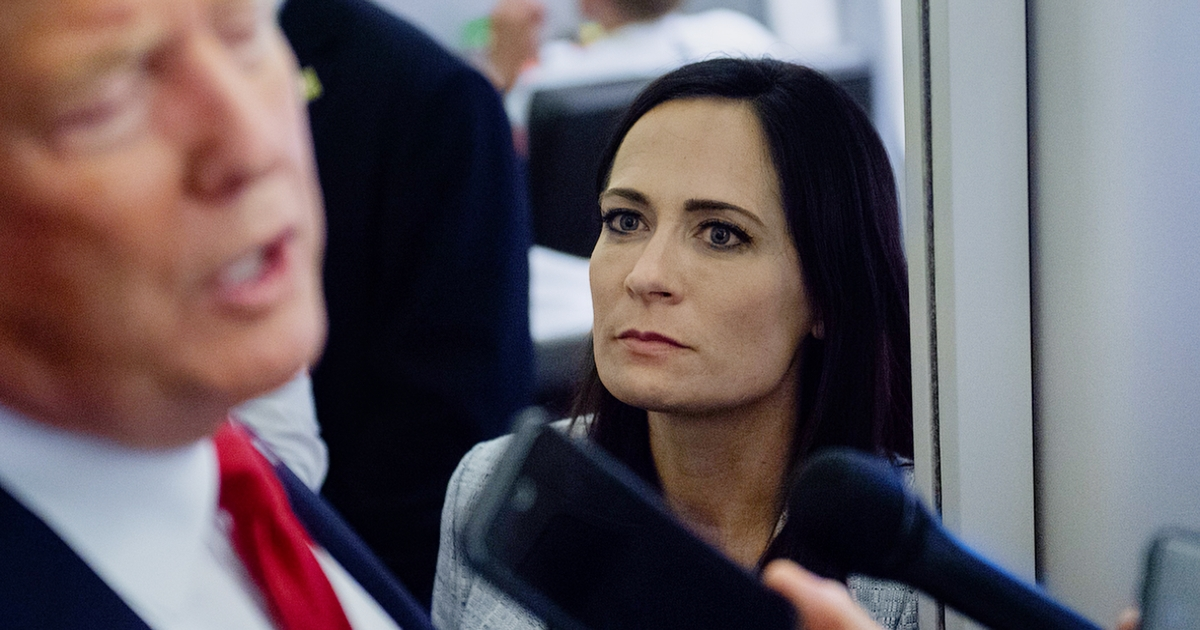 White House Press Secretary Stephanie Grisham listens to U.S. President Donald Trump speak to the media aboard Air Force One during a flight from El Paso, Texas to Joint Base Andrews, Md., On August 7, 2019.